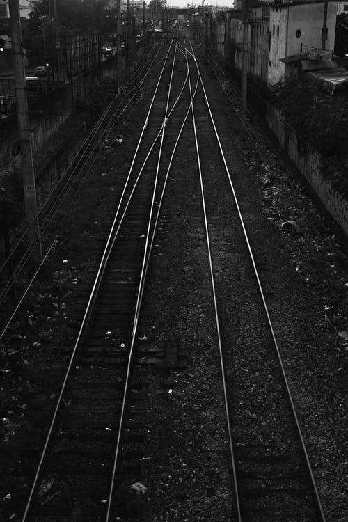 Monochrome Photo of Empty Railway Tracks