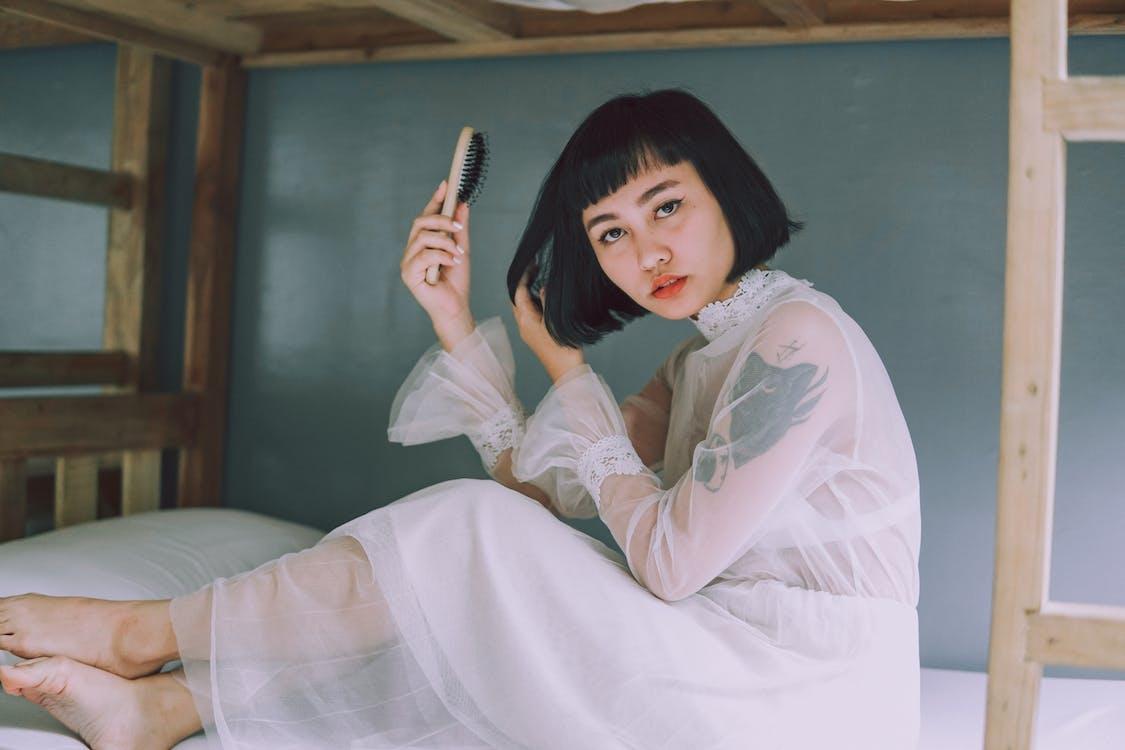 Photo Of Woman Holding Hair Brush
