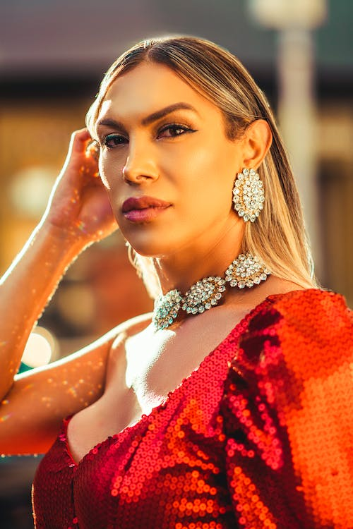Photo of Woman Wearing Diamond Earring and Necklace