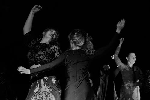 Grayscale Photography of Women Dancing
