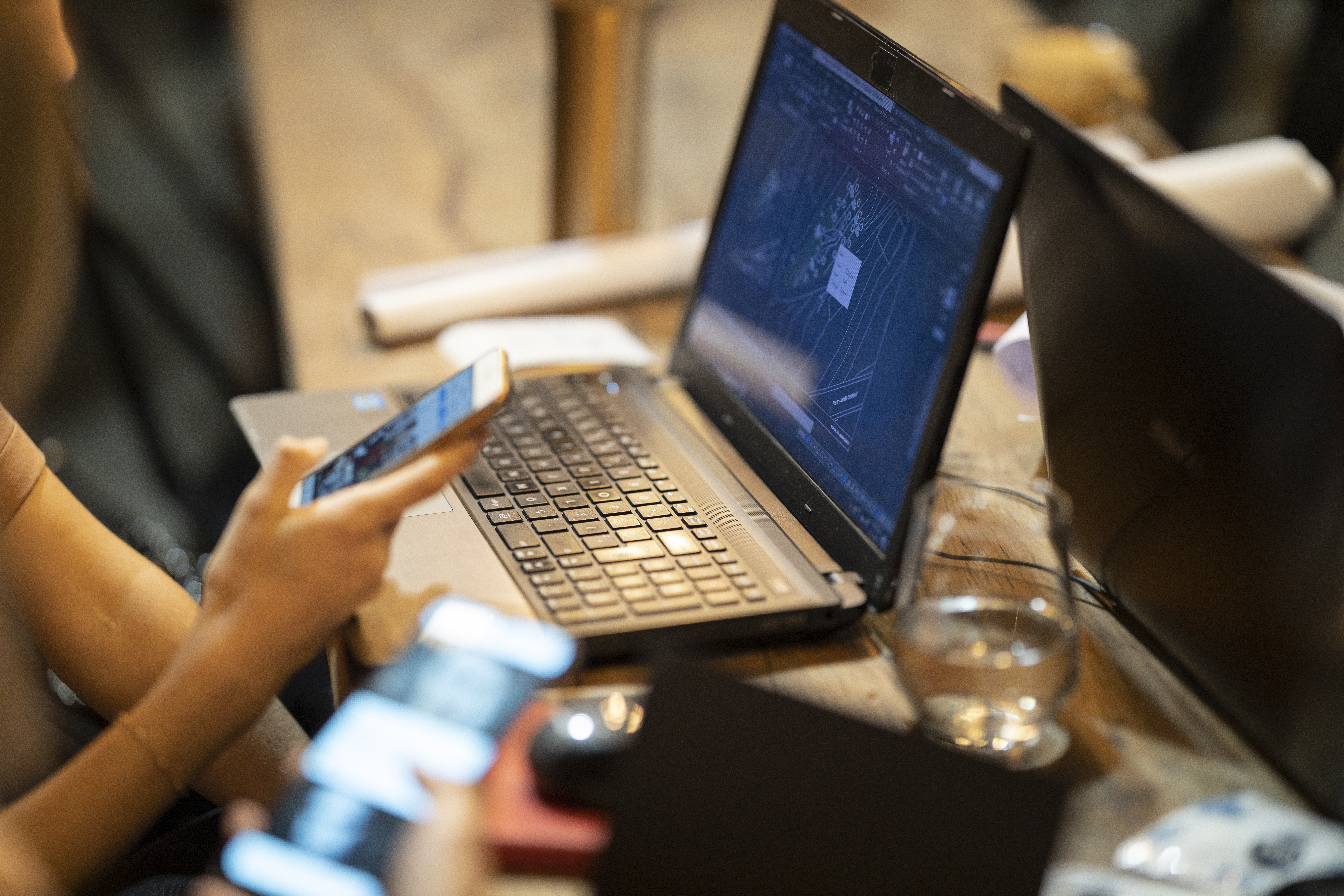Photo Of Person In Front Of Laptop