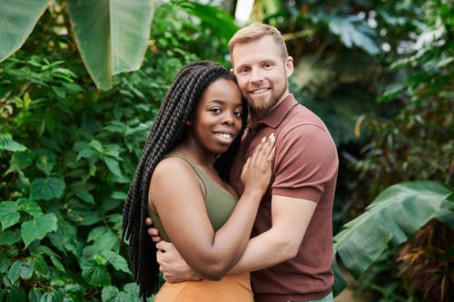 Shallow Focus Photo of Couple Embracing