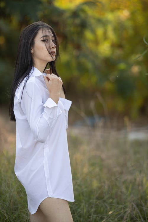 Photo Of Woman Wearing White Dress Shirt