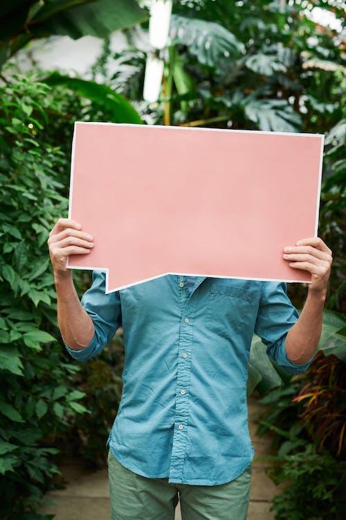 Photo Of Man Holding Signage