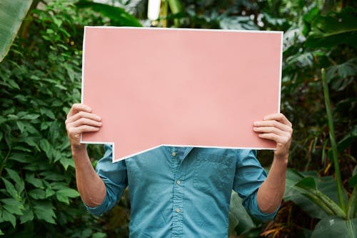 Photo of Person Holding Blank Signboard