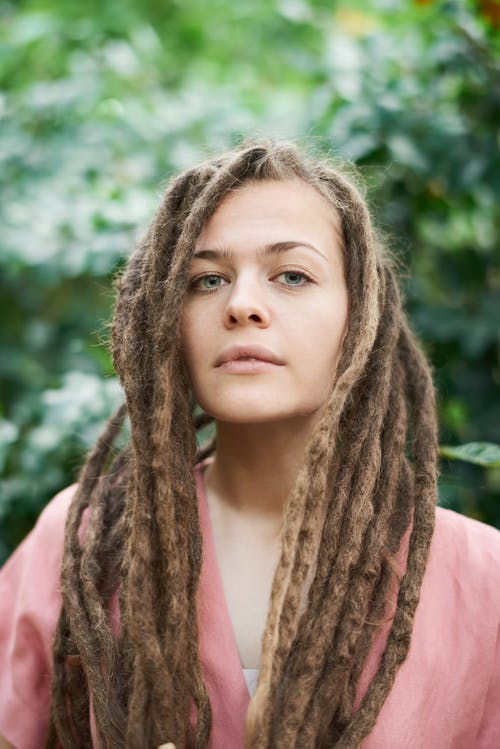 Shallow Focus Photo of Woman With Dreadlocks Hairstyle