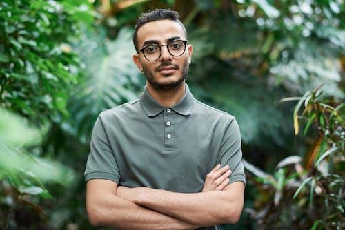 Selective Focus Photo of Man Wearing Eyeglasses and Polo Shirt