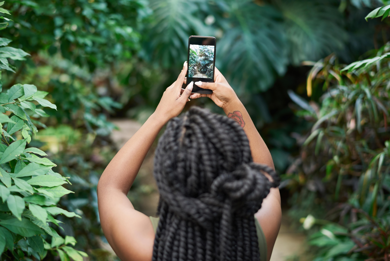 Woman Holding Black Smartphone
