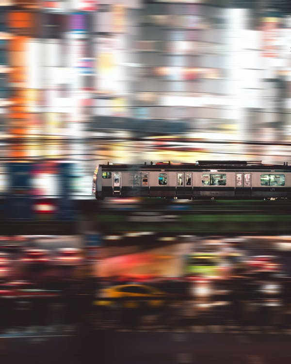 Time-lapse Photography of People Inside White and Black Train
