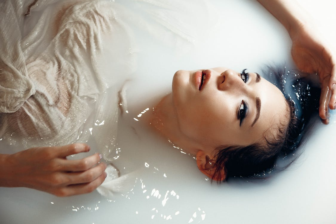 Woman in White Shirt Taking Bath on White Water