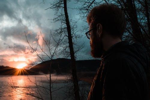 Free stock photo of 20-25 years old man, beard, Beautiful sunset, golden hour