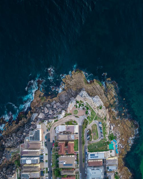 Aerial Photography of Buildings Beside Sea