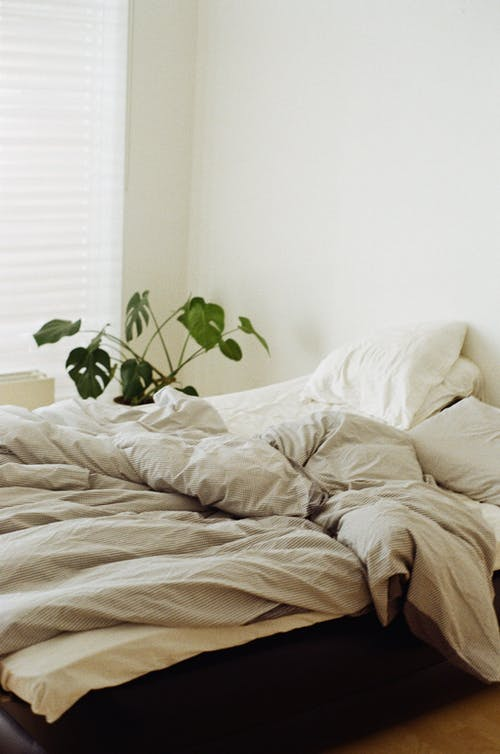 Messy White Bed Linen