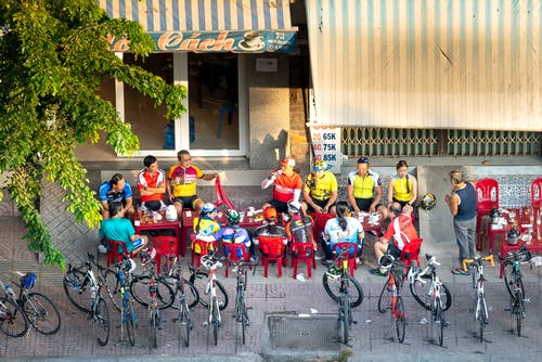 People Sitting Near Bicycles