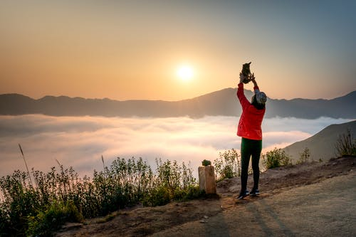 Photo Of Person Standing Near Sea Of Clouds