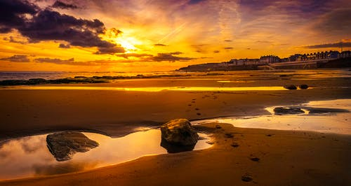Photo of Beach Sand During Golden Hour