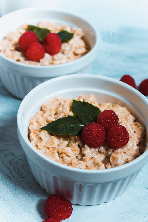 Muesli in Bowls Topped with Raspberries