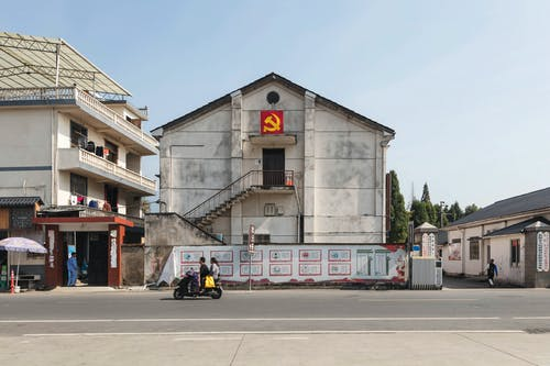 Suburban district buildings decorated with hammer and sickle emblem