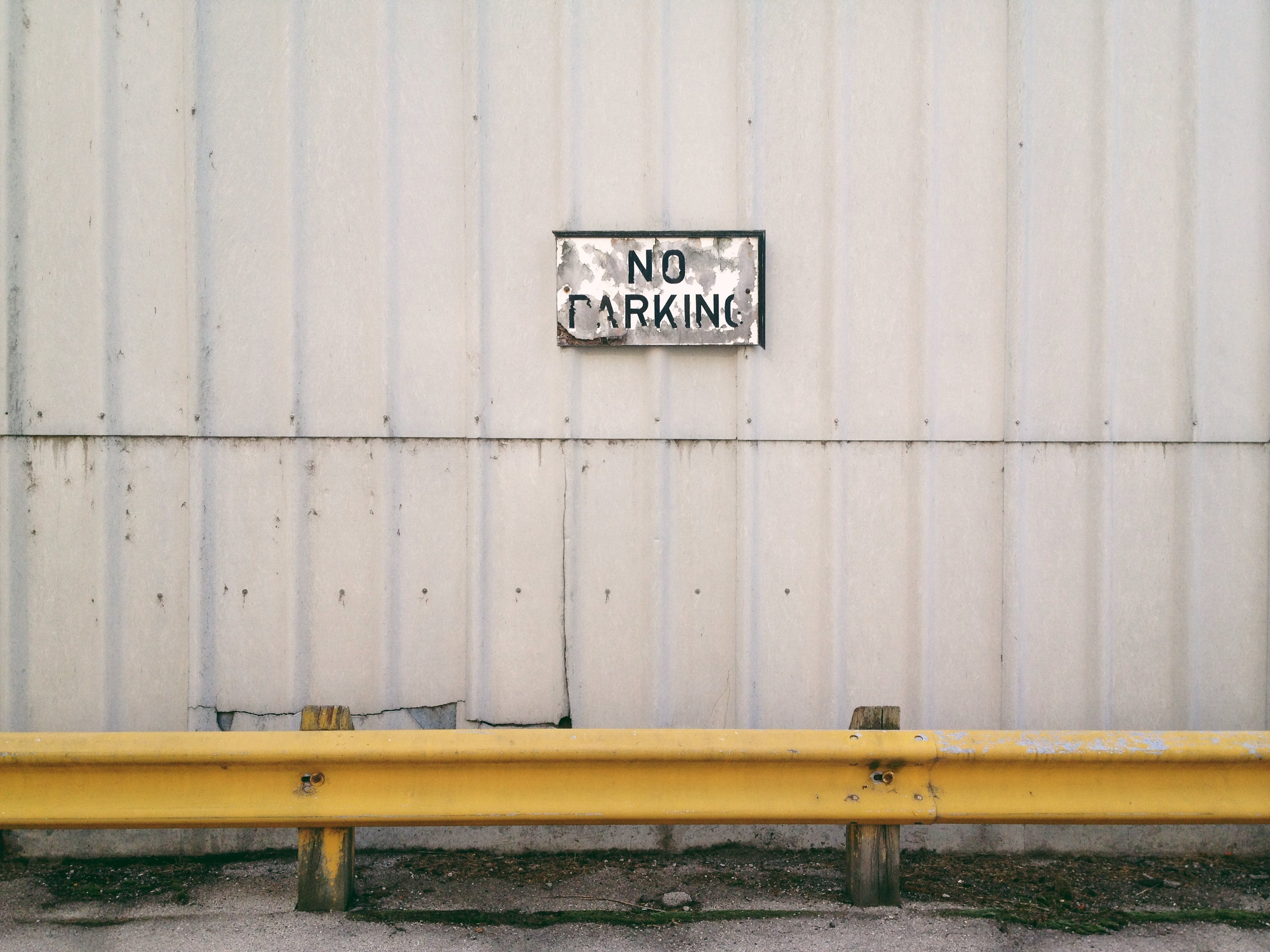 No Parking Sign on Wall