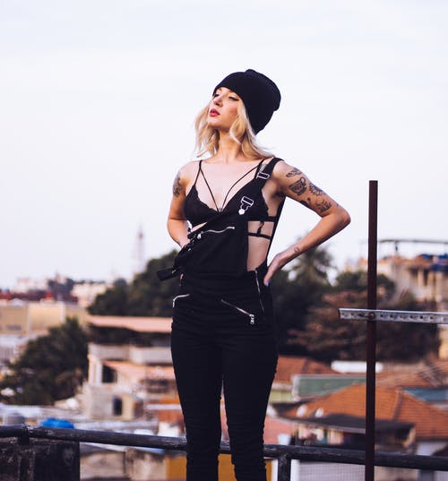 Woman Standing on the Rooftop Overlooking Houses