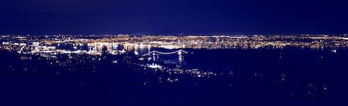 Kostenloses Stock Foto zu brücke, lichter der stadt, nacht, skyline