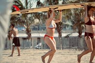 Women Carrying Surfboard