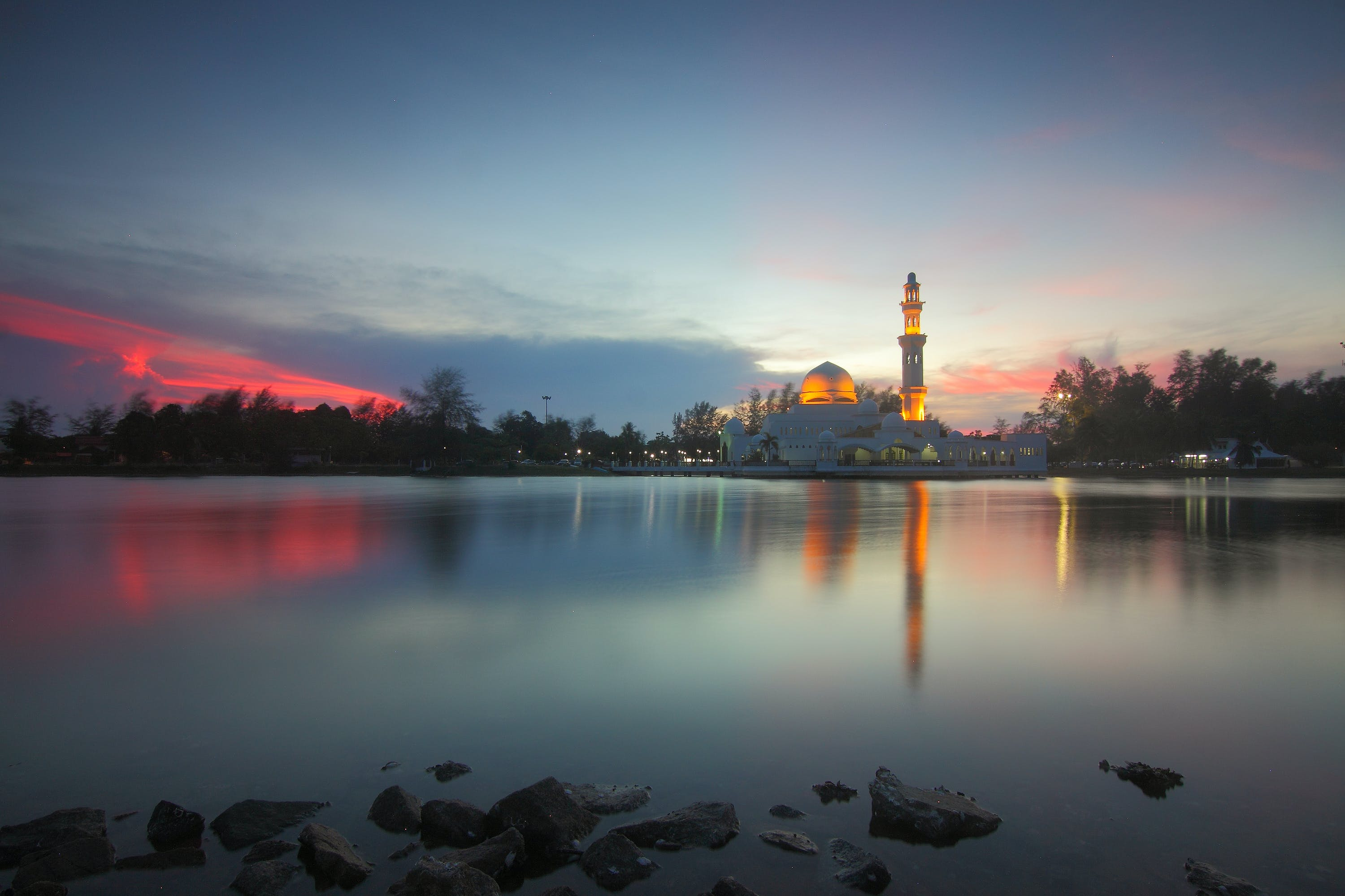 Mosque Near Body of Water during Golden Hour