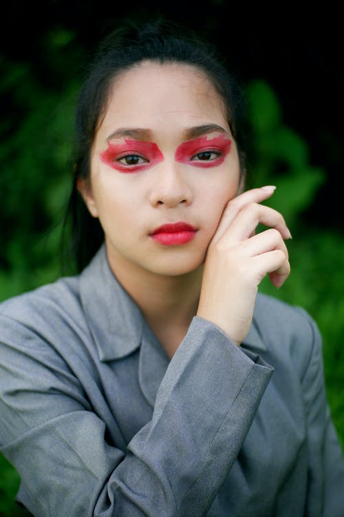 Woman with Red Paint on Her Eyes
