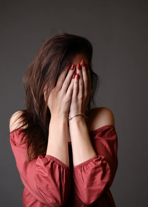 Standing Woman Hiding Face With Both Hands