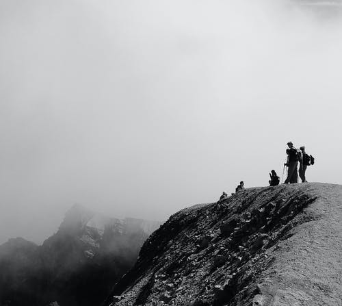 People At The Top Of A Mountain
