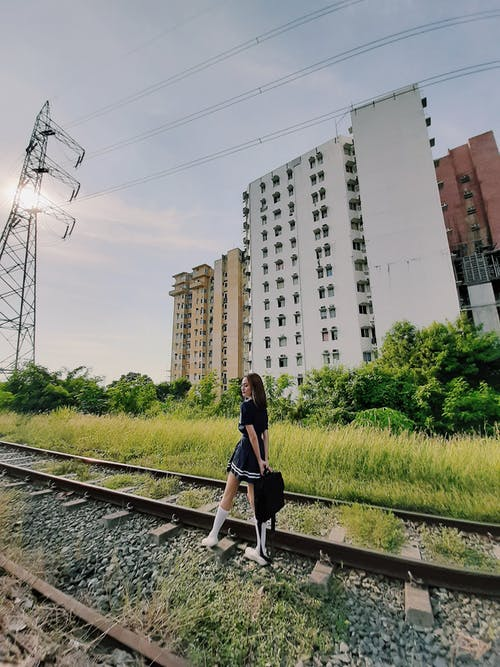 Woman Standing on Rail Track