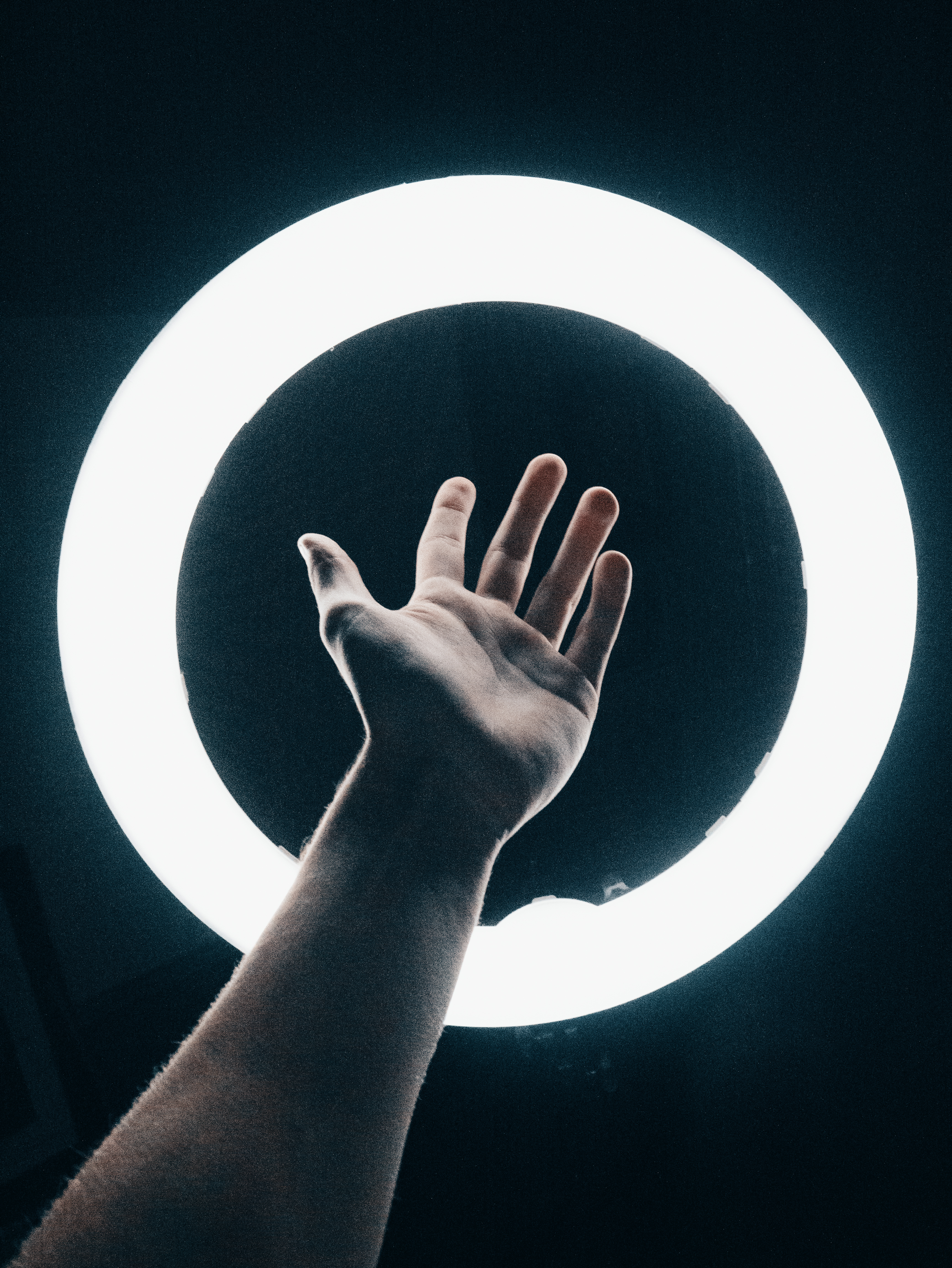 Person Holding Out Left Hand Onto Light