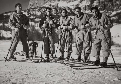 Greycale Photo of Men in Ski Blades