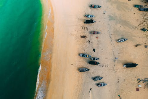 Aerial View of Row Boats on Seashore