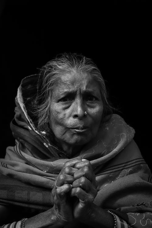 Monochrome Photography Of An Old Woman