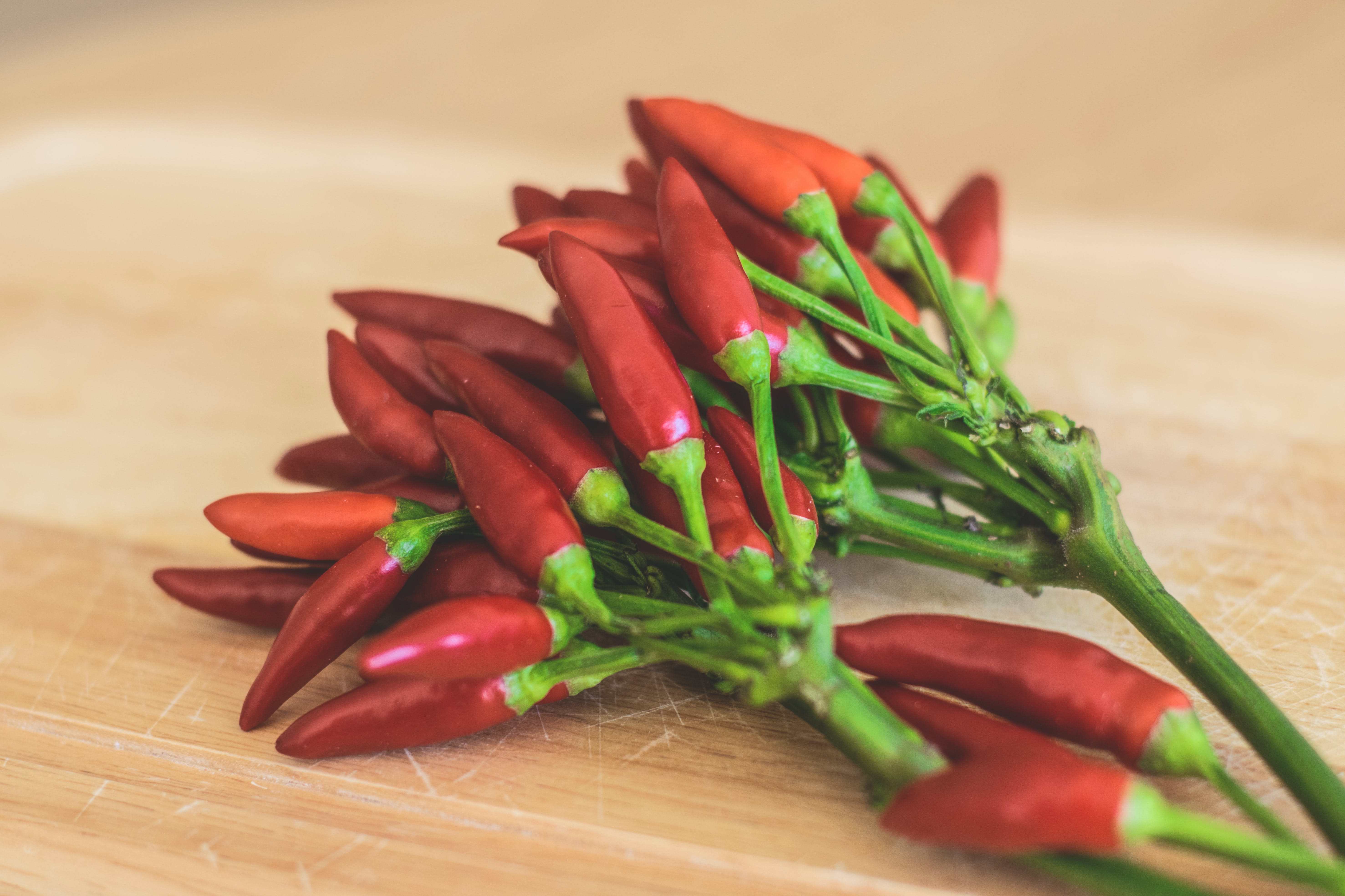 Red Chili Peppers on Brown Wooden Surface
