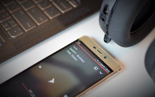 Free stock photo of headset, music, notebook, smartphone