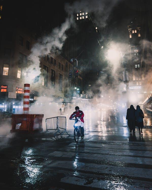 Man on Bike on Pedestrian Lane