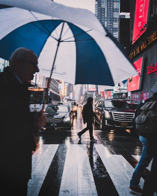 Photo Of Man Holding Umbrella