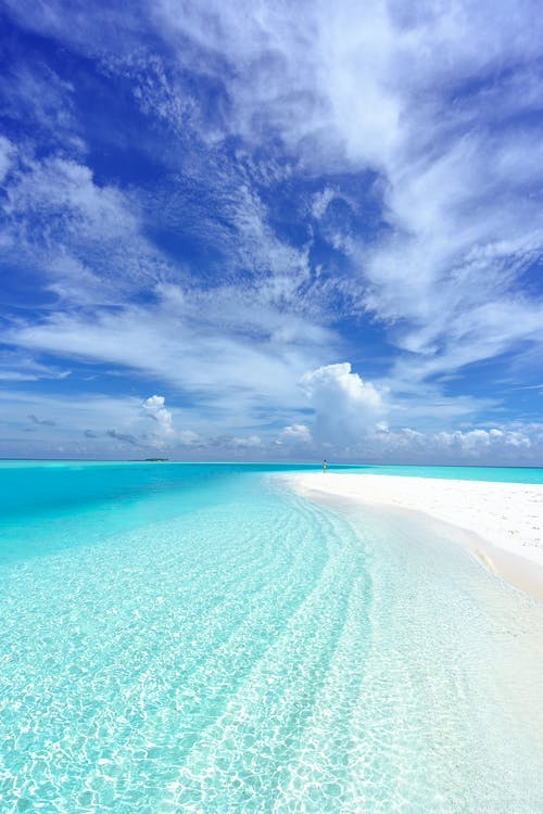 Photo of Beach Under Blue Sky Scenery