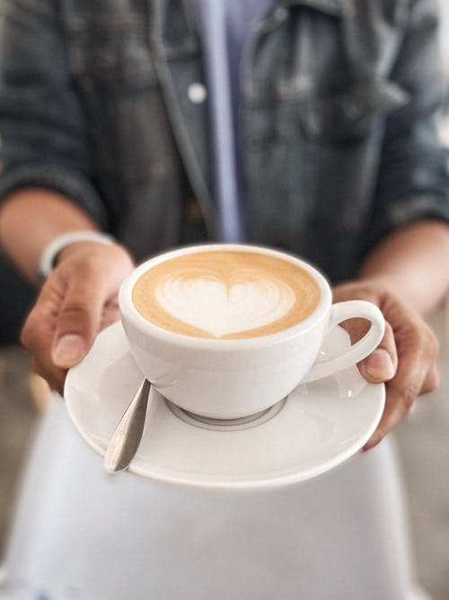 Photo Of Person Holding Coffee