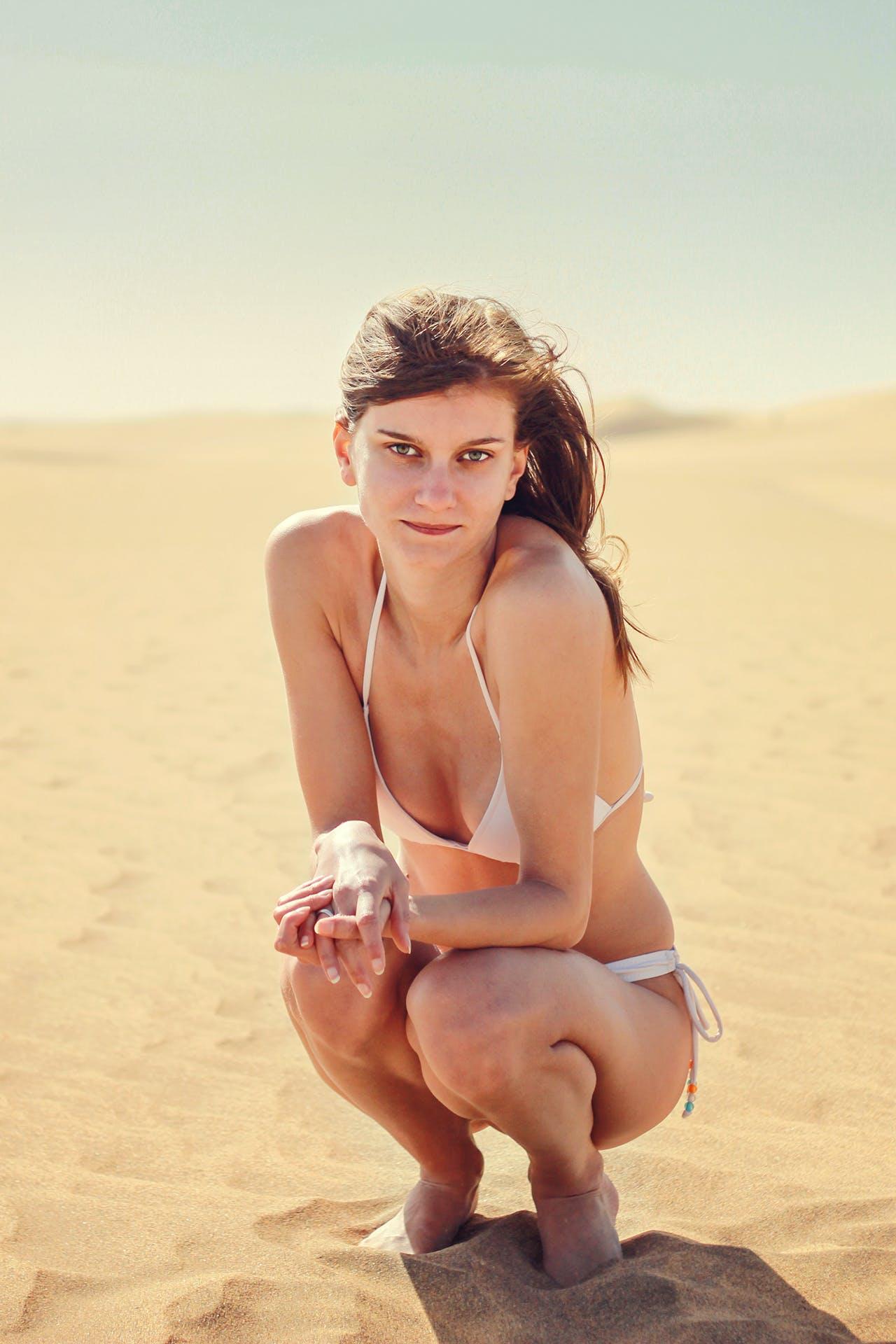 Woman Wearing White Bikini on Sand