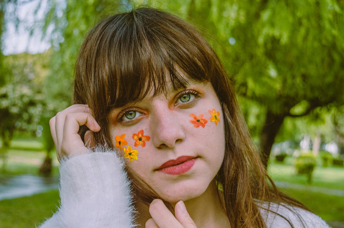 Selective Focus Photography of Woman With Flower Face Paint