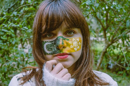 Teenage girl with colorful painted face