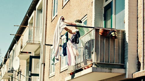 Low Angle View of Clothes Hanging on Balcony