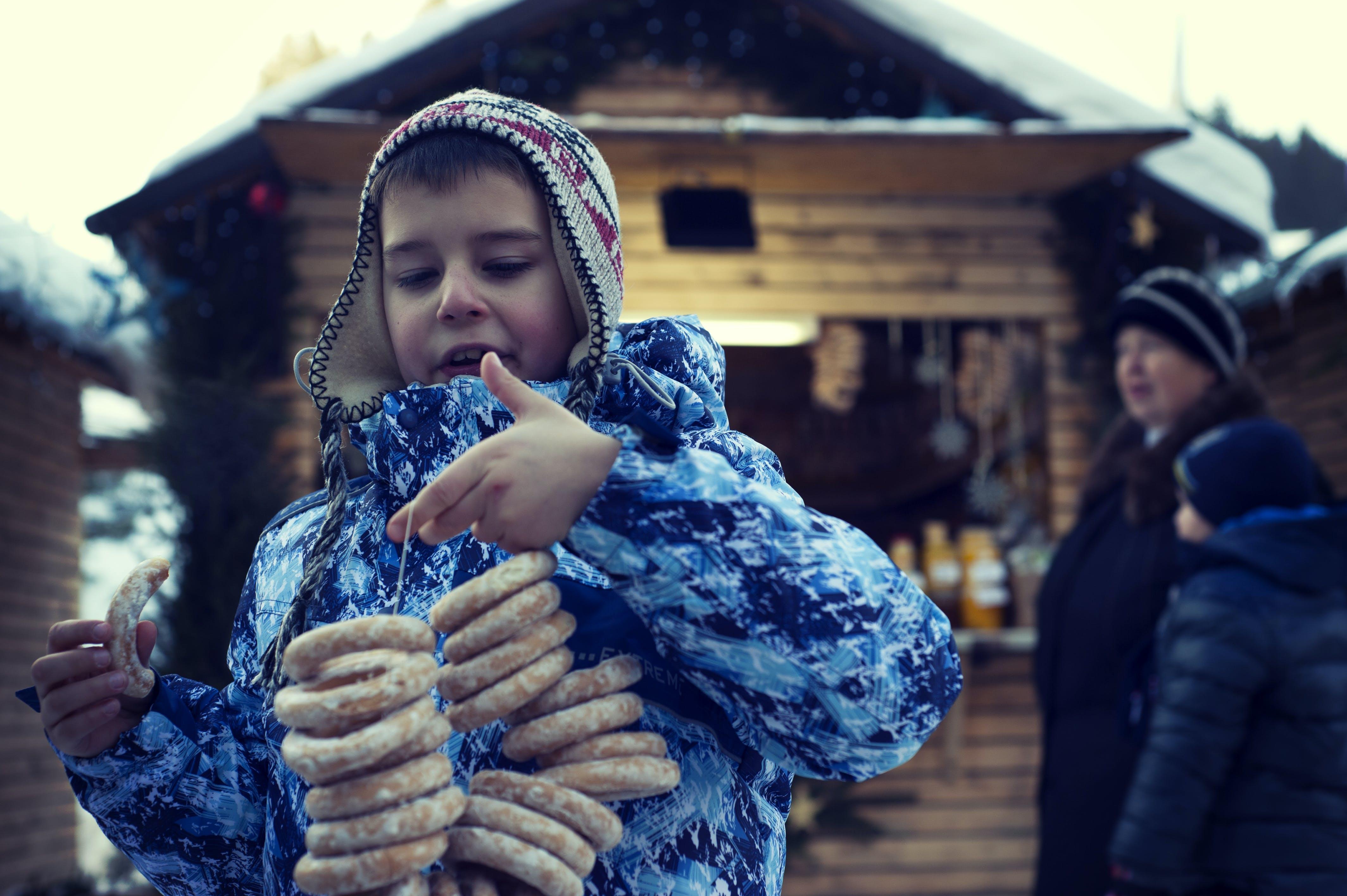 Boy Holding Doughnuts
