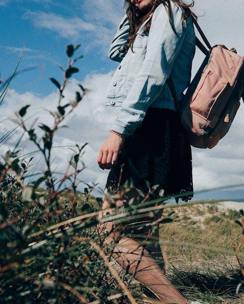 Woman Wearing Backpack Near Plants