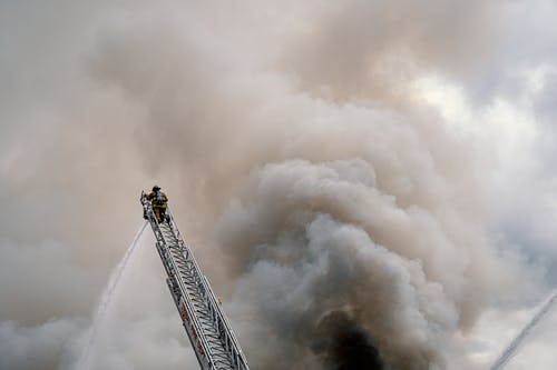 Fire Fighter At The Top Of A Ladder
