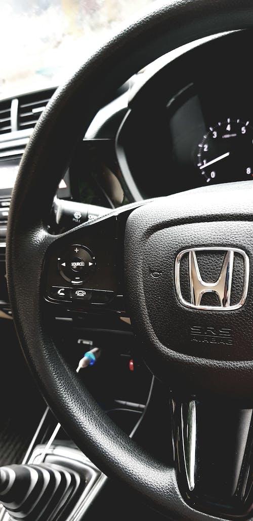 Ilmainen kuvapankkikuva tunnisteilla auto, auton sisustus, honda, musta auto