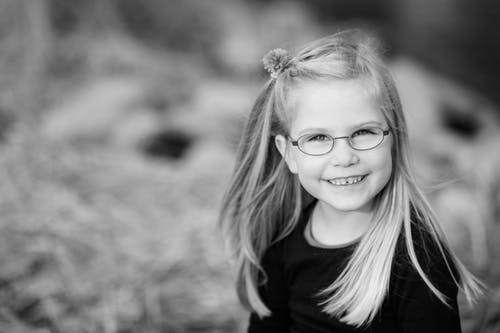 Grayscale Photography of Girl Smiling